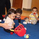 Children play during ECDC Birth to Three Monthly Session
