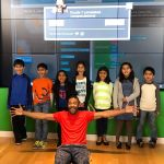 Students pose after completing coding challenge during Microsoft Workshop