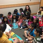 Little Rock students participating in summer read aloud activity